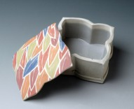 Foliate Box  Description: Hand-built white stoneware, slab construction and extrusion with colored slip inlay. A stencil I cut from Tyvek is placed on the damp slab and multiple colored slips are brushed through it. Exterior unglazed. Gas fired, cone 10 reduction.  Dimensions: H:3.00 x W:5.50 x D:5.50 Inches