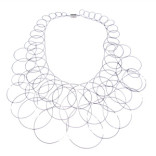 Golden Mean Description: Interwoven skeins of cable, looped on itself in a textile/crochet pattern crafted from nylon-coated stainless steel and sterling silver tubing as connectors. The piece forms a soft, flexible eqyptian-style collar with a steel magnetic clasp. Dimensions: H:12.00 x W:14.00 x D:0.25 Inches