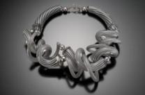 Grey Latticio Twist Necklace Description: Blown cane glass sculpted , cut polished Dimensions: H:8.00 x W:8.00 x D:2.00 Inches