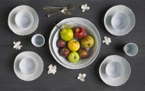 Description: Luncheon plates, soup bowls and juice cups on a table adorned with porcelain flowers and the centerpiece is two serving bowls nesting in one another.All pieces are sold individually.Dimensions and prices based on one stacked table setting consisting of lunch plate, small soup bowl and a juice cup.Dimensions: H:4.25 x W:7.00 x D:7.00 Inches