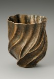 Description: Seamless copper vessel, hand raised (annealed and hammered in repetitive rounds from a flat copper disc with a diameter of 13 inches). Hammer formed, and chased with wax resist. Patina applied by the artists.Dimensions: H:7.50 x W:4.75 x D:4.75 Inches