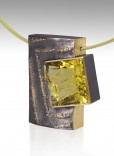 Description: Fabricated pendent in oxidized Sterling, 18k Green Gold, 55.34 ct chiseled Lemon Citrine, .22 diamond tcwDimensions: H:2.25 x W:2.00 x D:0.62 Inches