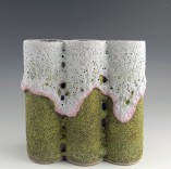 Description: Red Earthenware claybody, handbuilt, Multi-chromatic Crater Glazes applied.  Fired in electric kiln to 2160 degrees Fahrenheit with a controlled coolling.Dimensions: H:10.00 x W:10.00 x D:3.00 Inches