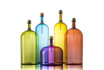 Description: Modernist colored glass bottles with opaque wrap and stopper details. Gold leaf accents. Price and dimensions for tallest styleDimensions: H:22.00 x W:5.00 x D:5.00 Inches