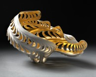 Description: Wheel thrown porcelain that has been altered, carved and incised. Fired to cone 10. Interior surface gilded with 23 ct. gold leaf.Dimensions: H:9.00 x W:13.00 x D:9.00 Inches