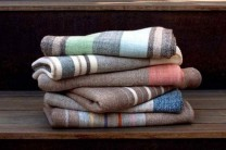 Description: Hand woven stack of naturally colored and plant-dyed merino wool blankets.Dimensions: H:72.00 x W:50.00 x D:0.00 Inches