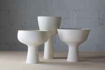 Description: Wheel thrown translucent porcelain with glazed interiors and unglazed polished exteriors. Set of 3 Pedestal Bowls.Dimensions: H:16.00 x W:30.00 x D:20.00 Inches