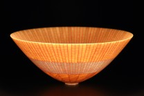 """Description: This vessel is made from 228 segments of birdseye maple. The glue lines are highlighted with red tint. The wall thickness is  1/32"""" making it translucent when lit from within.Dimensions: H:2.00 x W:5.00 x D:5.00 Inches"""