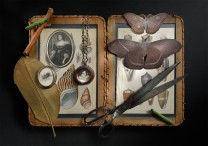 Description: Vignette of pieces hand fabricated, constructed, soldered, patinated, bezel set- including found objects. Copper, sterling silver, fine silver, steel, antique prints, glass, watchmaker's crystal, slateDimensions: H:9.00 x W:14.00 x D:0.75 Inches