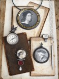 Description: Assemblage of objects hand fabricated by the artists in vignette presentation- copper, fine silver, sterling silver, glass, carnelian, compass, brass, leather, wood, found objects, altered 19th century prints- constructed, soldered, bezel st elementsDimensions: H:15.00 x W:8.00 x D:1.00 Inches