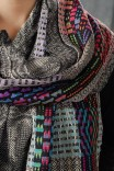 Description: 100 % Silk Hand woven and Hand-dyed. One scarf is a 24 harness network draft of swirls and diamonds entering and receding from each other. The other is my Blocks pattern, a sampler with no repeats across the whole length.Dimensions: H:72.00 x W:9.00 x D:0.00 Inches
