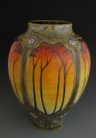 """Description: Wheel thrown and handcarved porcelain vase, 11"""" in height.  Panels of decoration are handpainted lustre and underglazes.Dimensions: H:11.00 x W:7.00 x D:7.00 Inches"""