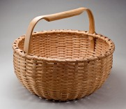 Description: Hand crafted of brown ash splint. Pounded, hand scraped, woven. The handles and rims are hand split, carved, and green bent.Dimensions: H:15.00 x W:18.00 x D:18.00 Inches