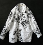 Description: Heavily stenciled tyvek jacket.One of a kind.With carabiner and grommet closure.Dimensions: H:30.00 x W:20.00 x D:2.00 Inches